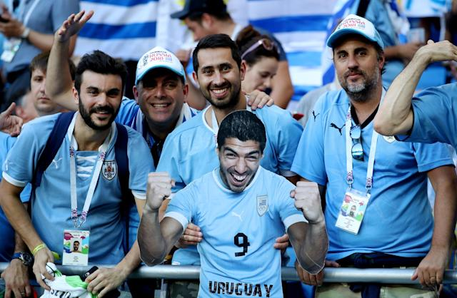 Soccer Football - World Cup - Group A - Uruguay vs Saudi Arabia - Rostov Arena, Rostov-on-Don, Russia - June 20, 2018 Uruguay fans with a cut out of Luis Suarez before the match REUTERS/Marko Djurica