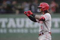 Cincinnati Reds' Jonathan India gestures to the dugout after hitting an RBI-double during the second inning of a baseball game against the Milwaukee Brewers, Monday, June 14, 2021, in Milwaukee. (AP Photo/Aaron Gash)