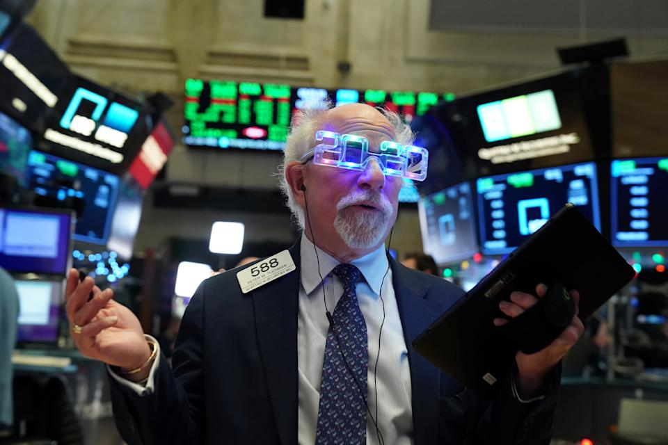 Trader Peter Tuchman wears 2020 glasses to celebrate the New Year at the New York Stock Exchange (NYSE) in New York, U.S., December 31, 2019. REUTERS/Bryan R Smith
