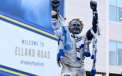 Scarves are draped over a statue of Leeds legend Billy Bremner - Credit: getty images