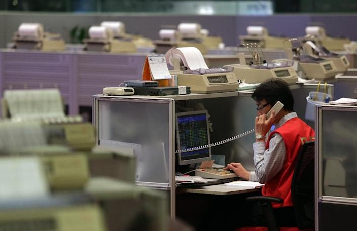 Shares on the Hang Seng Index have plunged 3.82% to near four-year lows on fears over the health of the Chinese economy and weak oil prices, with mainland-linked chips taking a hammering (AFP Photo/Isaac Lawrence)