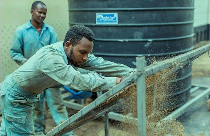 Matee's Gjenge Makers Ltd. team mixes sand with recycled plastics to produce the finished bricks.