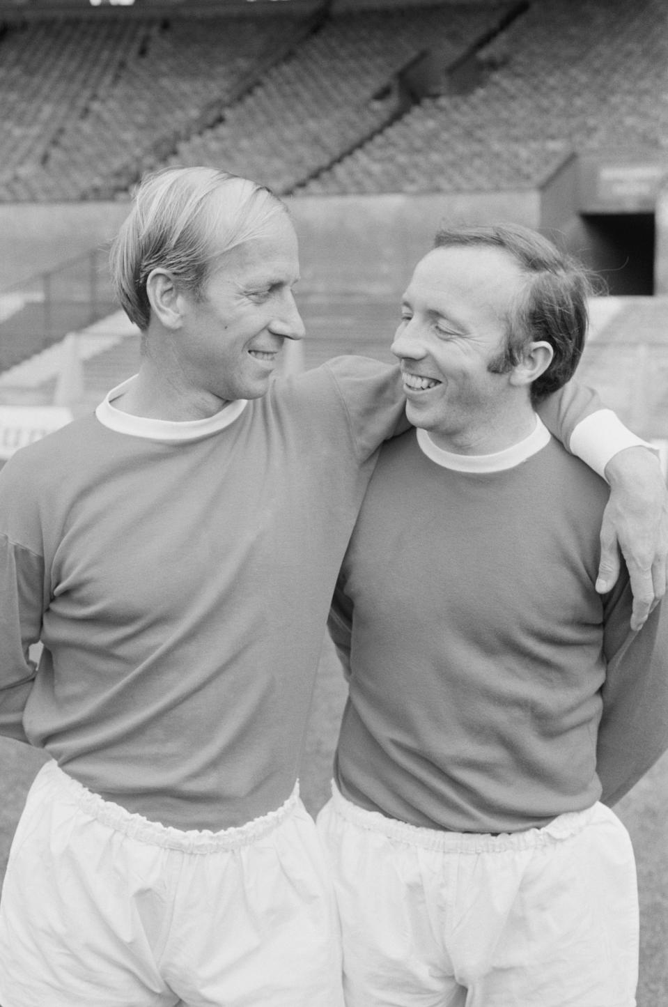 English soccer players Bobby Charlton and Nobby Stiles of Manchester United FC, UK, 1st August 1968. (Photo by Evening Standard/Hulton Archive/Getty Images)