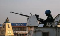 A MINUSCA armoured personnel carrier keep guard as they patrol the streets ahead of the upcoming elections in Bangui