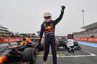 Red Bull driver Max Verstappen of the Netherlands waves to the crowd after he clocked the fastest time during the qualifying session ahead of the French Formula One Grand Prix at the Paul Ricard racetrack in Le Castellet, southern France, Saturday, June 19, 2021. The French Grand Prix will be held on Sunday. (Nicolas Tucat/Pool via AP)