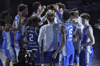Duke players gather prior to the start of an NCAA college basketball game against Louisville in the second round of the Atlantic Coast Conference tournament in Greensboro, N.C., Wednesday, March 10, 2021. Duke has pulled out of the Atlantic Coast Conference Tournament and ended its season after a positive coronavirus test and the resulting quarantining and contact tracing. The ACC announced that the Blue Devils quarterfinal game with Florida State scheduled for Thursday night has been canceled. (AP Photo/Gerry Broome)