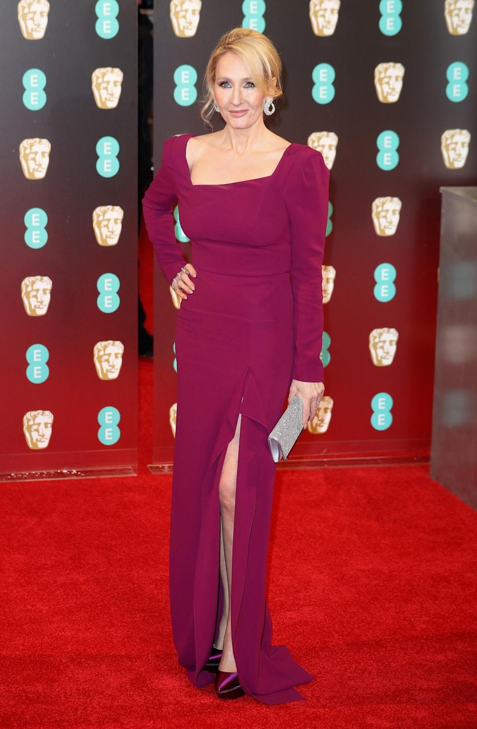 <p>The world-famous author wore an asymmetrical purple gown by Roland Mouret with matching platforms. <i>[Photo: Getty]</i> </p>