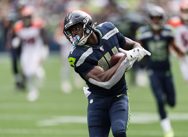 Sep 8, 2019; Seattle, WA, USA; Seattle Seahawks wide receiver D.K. Metcalf (14) carries the ball after catching a pass against the Cincinnati Bengals during the first half at CenturyLink Field. Mandatory Credit: Steven Bisig-USA TODAY Sports