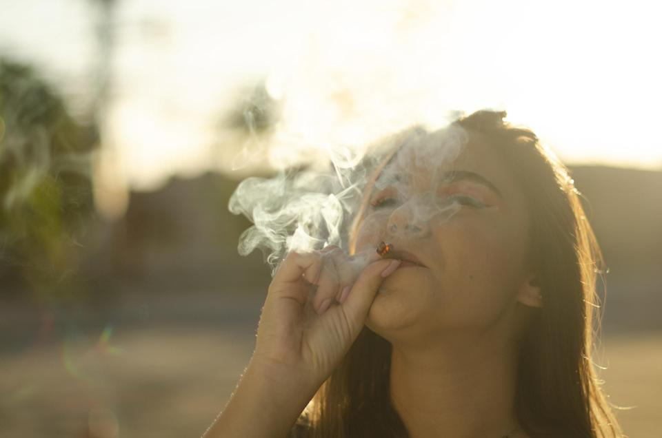 An image of a woman smoking weed