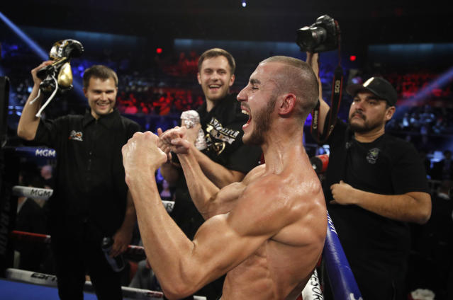 FILE - In this Saturday, Oct. 20, 2018 file photo, Maxim Dadashev celebrates after defeating Antonio DeMarco during a junior welterweight bout in Las Vegas. On Saturday, July 20, 2019, doctors said Dadashev had surgery at a Maryland hospital for swelling on his brain after collapsing outside the ring after losing a match. (AP Photo/John Locher)