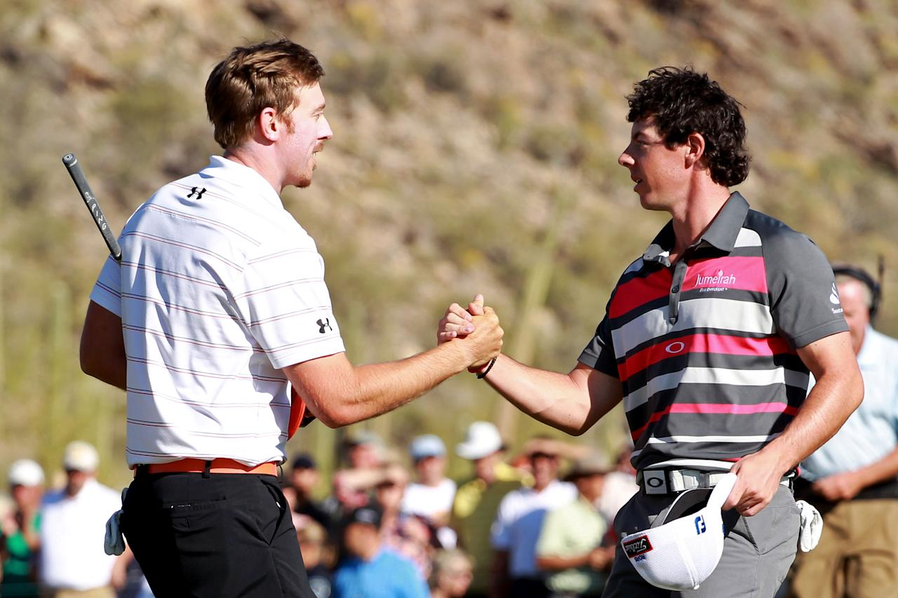 MARANA, AZ - FEBRUARY 26: (L-R) Hunter Mahan of the United States shakes hands with Rory McIlroy of Northern Ireland after winning the championship match 2 and 1 on the 17th hole during the final round of the World Golf Championships-Accenture Match Play Championship at the Ritz-Carlton Golf Club on February 26, 2012 in Marana, Arizona.  (Photo by Andy Lyons/Getty Images)