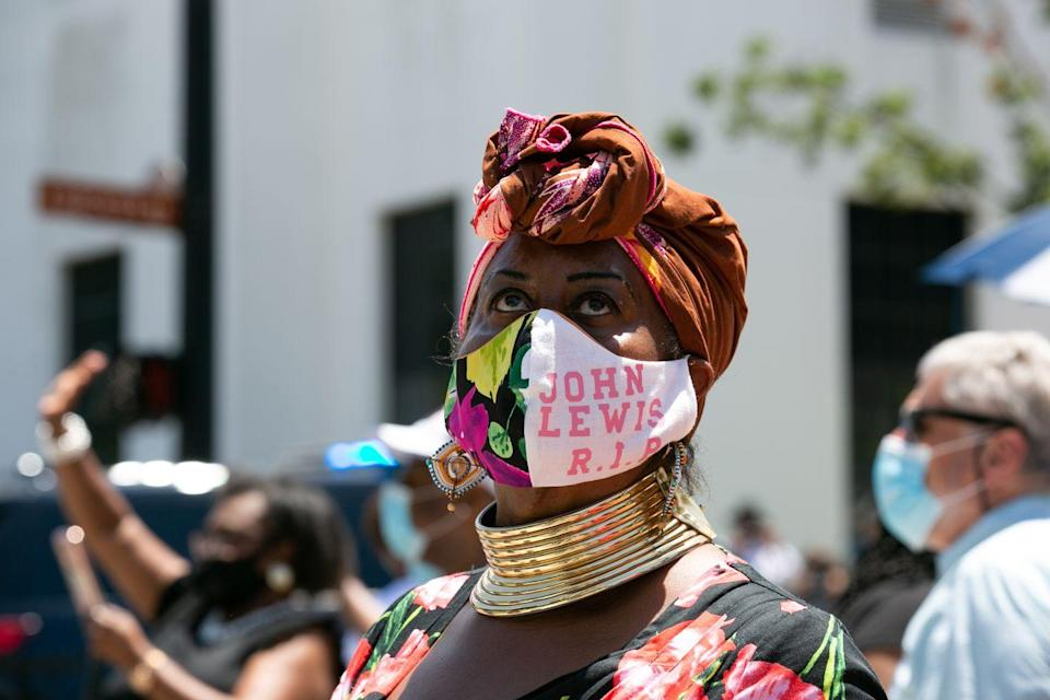 "<p>Marion Glaser, a mourner, traveled from Mississippi to Montgomery in order to view Lewis's funereal procession. Glaser wore a protective face mask which read: ""John Lewis R.I.P.""<br></p>"