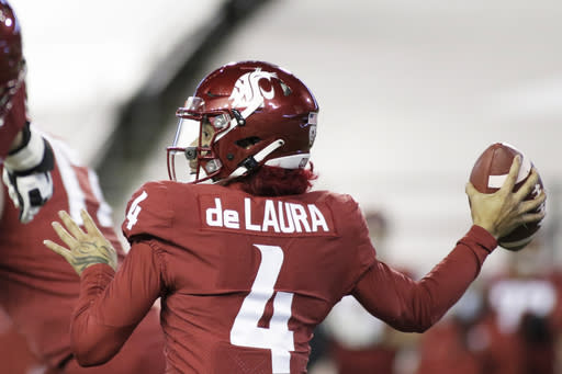 Washington State quarterback Jayden de Laura (4) throws a pass during the first half of the team's NCAA college football game against Oregon in Pullman, Wash., Saturday, Nov. 14, 2020. (AP Photo/Young Kwak)