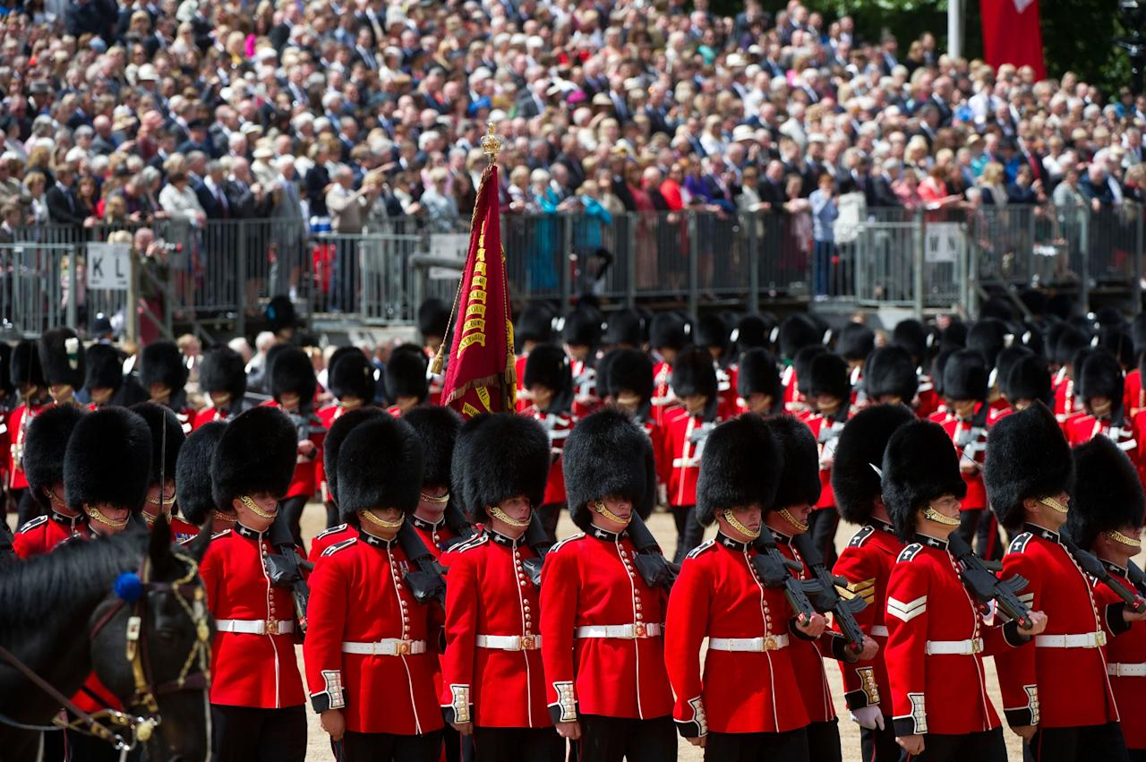 LONDON, ENGLAND - JUNE 15: General view of members of the Queen's Guard marching during the Trooping Of The Colour at Horse Guards Parade on June 15, 2013 in London, England. Today's ceremony which marks the Queens official birthday will not be attended by Prince Philip the Duke of Edinburgh as he recuperates from abdominal surgery and will also be The Duchess of Cambridge's last public engagement before her baby is due to be born next month. (Photo by Bethany Clarke/Getty Images)