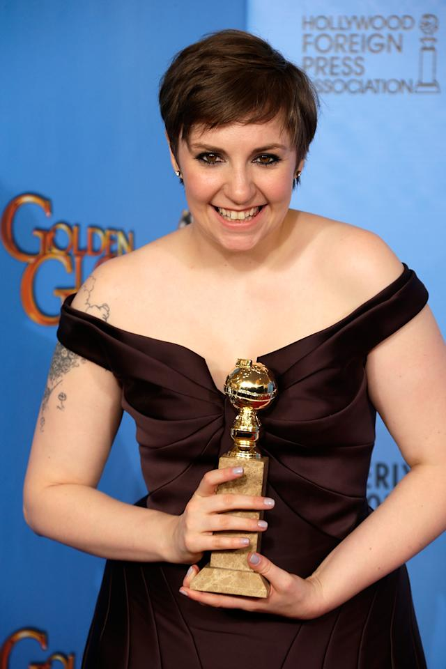 Actress-director Lena Dunham poses in the press room at the 70th Annual Golden Globe Awards held at The Beverly Hilton Hotel on January 13, 2013 in Beverly Hills, California.