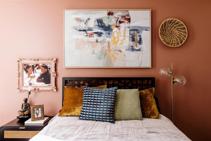 "Rich colors are found throughout the apartment: ""Going with the bold yet sultry palette allowed us to turn a white box into an intriguing and warm environment,"" Jannah and Kiyanna say of their approach to the colors."
