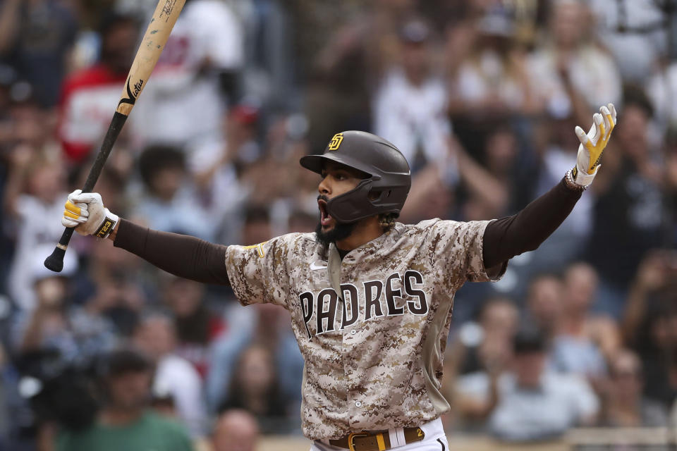 San Diego Padres' Fernando Tatis Jr. reacts after being called out on strikes in the ninth inning of a baseball game against the Atlanta Braves, Sunday, Sept. 26, 2021, in San Diego. (AP Photo/Derrick Tuskan)