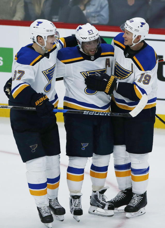 St. Louis Blues Klim Kostin (37), David Perron (57) and Jay Bouwmeester (19) celebrate Perron's winning goal against the Winnipeg Jets in overtime NHL hockey game action in Winnipeg, Manitoba, Friday, Sept. 20, 2019. (John Woods/The Canadian Press via AP)