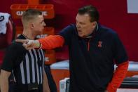 Illinois head coach Brad Underwood argues a call during the first half of an NCAA college basketball game against the Wisconsin Saturday, Feb. 27, 2021, in Madison, Wis. (AP Photo/Morry Gash)