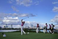Cameron Smith, of Australia, tees off on the 14th hole in the final round at The Northern Trust golf tournament at Liberty National Golf Course Monday, Aug. 23, 2021, in Jersey City, N.J. (AP Photo/John Minchillo)