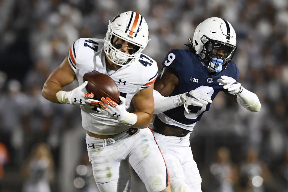 Auburn tight end John Samuel Shenker (47) catches a pass in front of Penn State cornerback Joey Porter Jr. (9) during an NCAA college football game in State College, Pa., on Saturday, Sept. 18, 2021. (AP Photo/Barry Reeger)