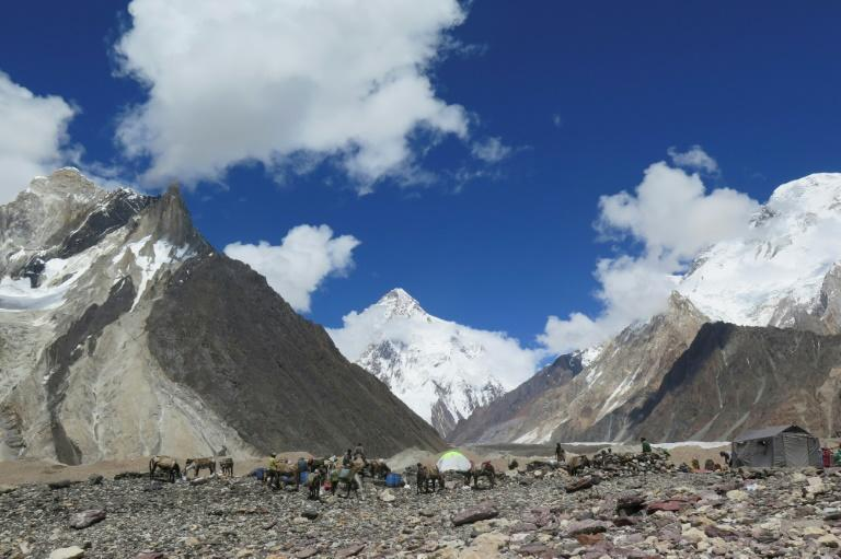 """K2 (C, pictured August 2019) is known as the """"Savage Mountain"""" because of its punishing conditions: winds can blow at more than 200 kilometres per hour (125 miles per hour), and temperatures can drop to minus 60 degrees Celsius (minus 76 Fahrenheit)"""