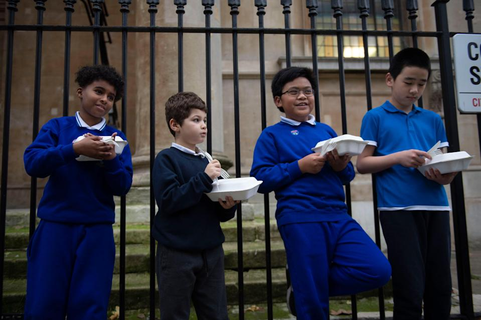 <p>Food for now: children with their Felix takeaways in central London. Experts warn today that hunger can leave children with stress, problems with concentration and anxiety</p> (Lucy Young)