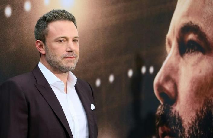 """The absence of these glitzy premiere images of stars such as Ben Affleck has heightened demand for the """"street snaps"""" delivered by paparazzi (AFP Photo/JEAN-BAPTISTE LACROIX)"""