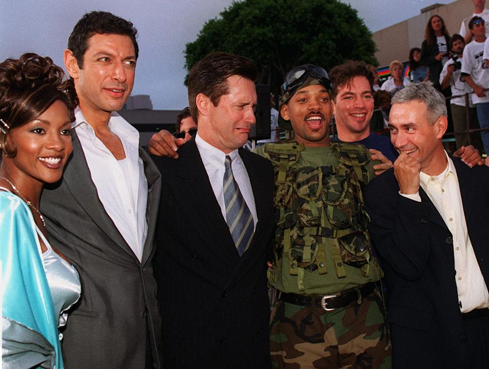 """Will Smith, wearing military fatigues, star of """"Independence Day"""" poses for a photo with fellow cast members, from left to right, Vivica Fox, Jeff Goldblum, Bill Pullman, Smith, singer Harry Connick Jr., and German director/executive producer/co-creator Roland Emmerich during the film's premiere in the Westwood section of Los Angeles Tuesday, June 25, 1996. (AP Photo/Kevork Djansezian)"""