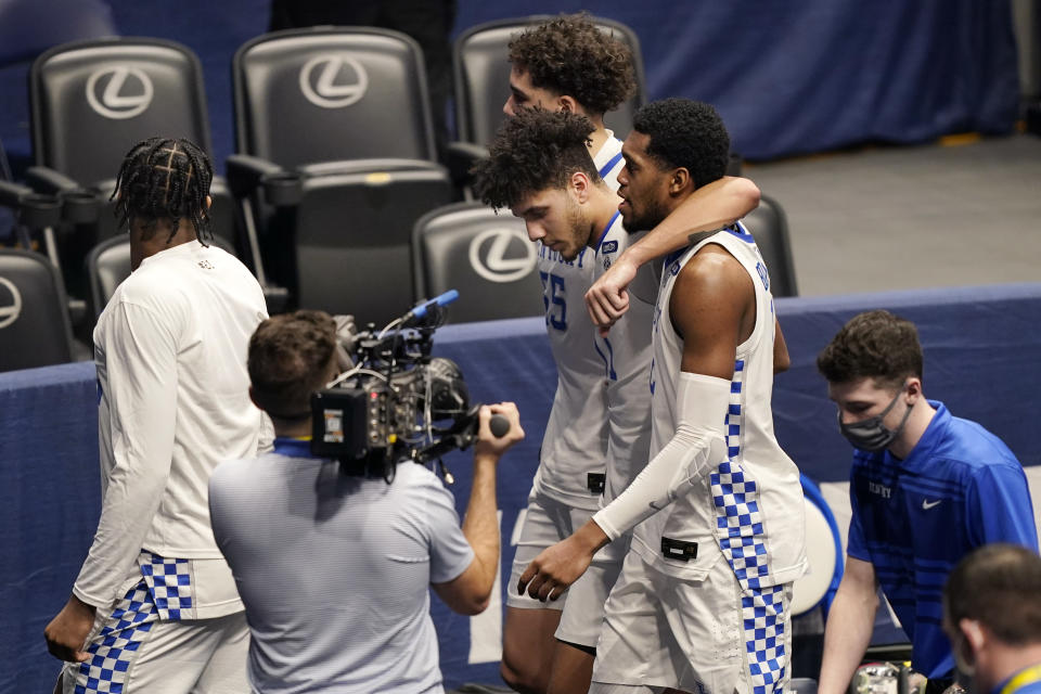 Kentucky players leave the court after losing to Mississippi State in an NCAA college basketball game in the Southeastern Conference Tournament Thursday, March 11, 2021, in Nashville, Tenn. (AP Photo/Mark Humphrey)
