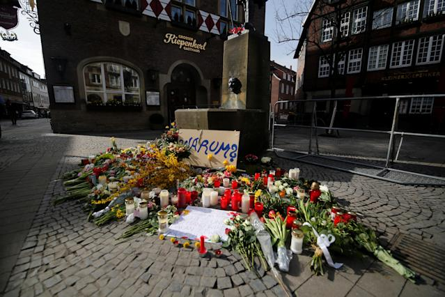 "<p>Candles and flowers are placed at the site where, on April 7, a man drove a van into a group of people sitting outside a popular restaurant in the old city centre of Muenster, Germany April 8, 2018. Placard reads ""Why?"". (Photo: Leon Kuegeler/Reuters) </p>"