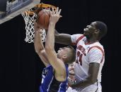 Louisville forward Montrezl Harrell (24) blocks a shot by Duke forward Mason Plumlee during the first half of the Midwest Regional final in the NCAA college basketball tournament, Sunday, March 31, 2013, in Indianapolis. (AP Photo/Darron Cummings)