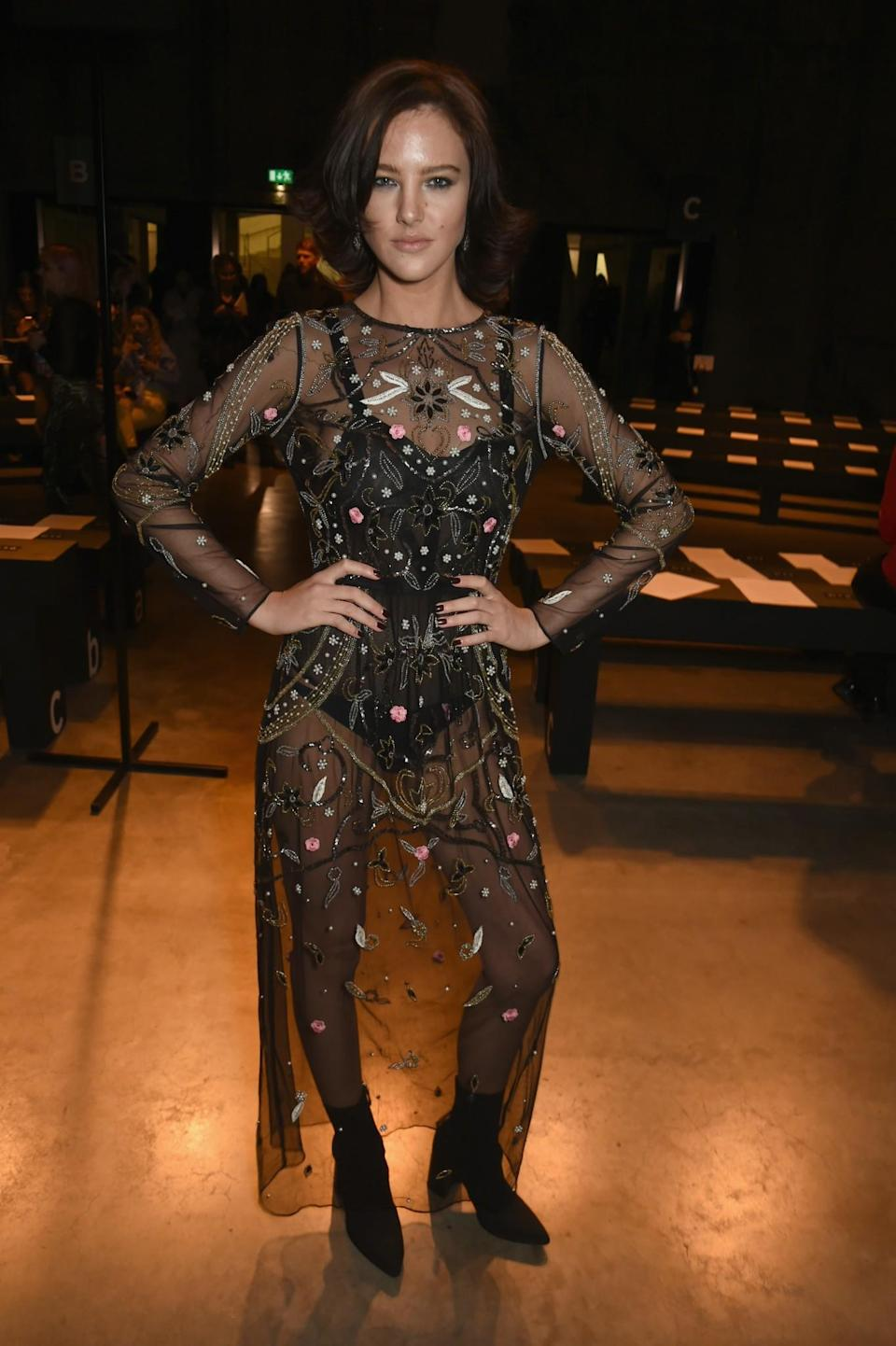 <p>Model Eliza Cummings opted for a sheer floral dress. <i>[Photo: Getty]</i> </p>