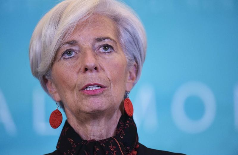 International Monetary Fund Managing Director Christine Lagarde, said on November 30, 2015 the yuan's inclusion in the elite reserve currency basket was expected to help China open up further to the world economy (AFP Photo/Mandel Ngan)