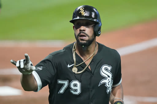 Chicago White Sox's Jose Abreu celebrates after hitting a solo home run in the sixth inning of a baseball game against the Cleveland Indians, Tuesday, Sept. 22, 2020, in Cleveland. (AP Photo/Tony Dejak)