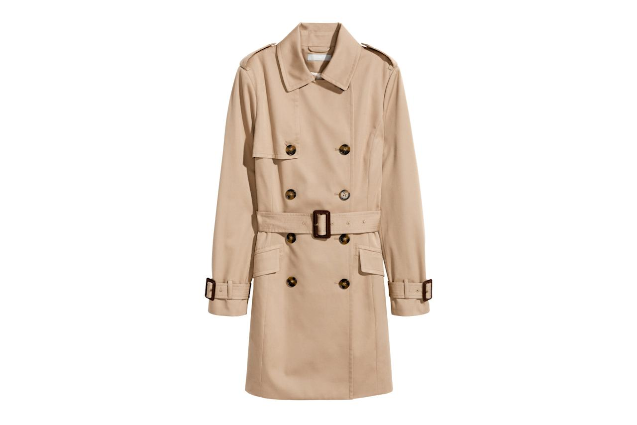 """<p>Classic for a reason, the khaki color and mid-thigh cut will never goout of style. Simply toss it on over whatever you're already wearing(from weekend jeans to workday separates). Also available in black.<br /> <br /> <strong>To buy:</strong> $70, <a rel=""""nofollow"""" href=""""http://www.hm.com/us/product/64729?article=64729-B&cm_vc=SEARCH"""">hm.com</a>.</p>"""