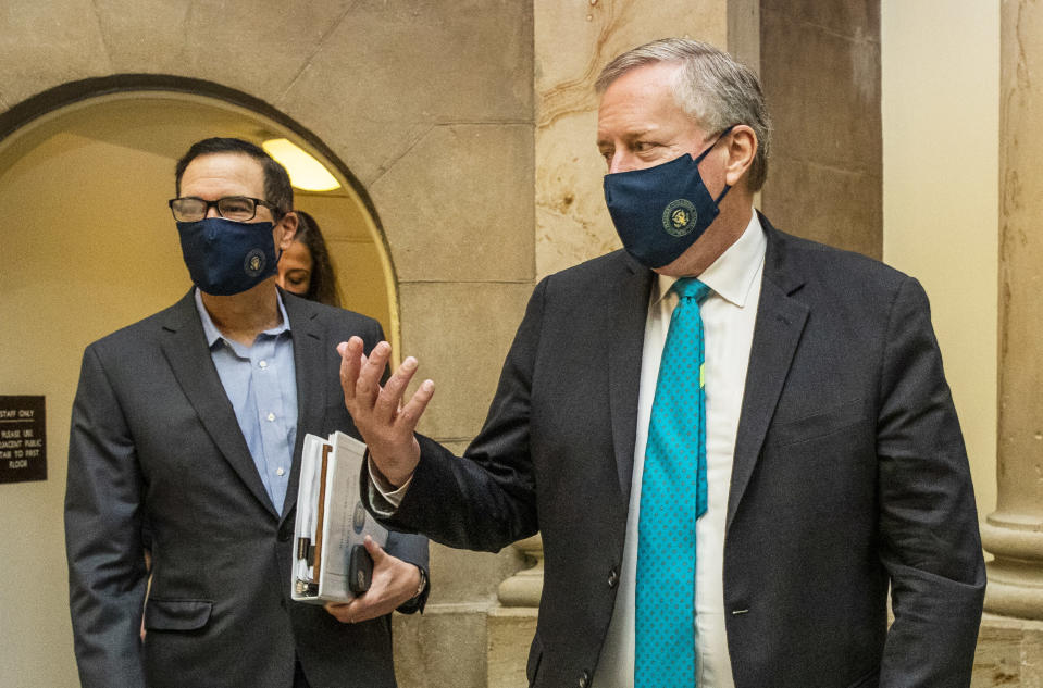 White House chief of staff Mark Meadows, right, and Treasury Secretary Steven Mnuchin, arrive at the office of House Speaker Nancy Pelosi at the Capitol to resume talks on a COVID-19 relief bill, Saturday, Aug. 1, 2020, in Washington. (AP Photo/Manuel Balce Ceneta)