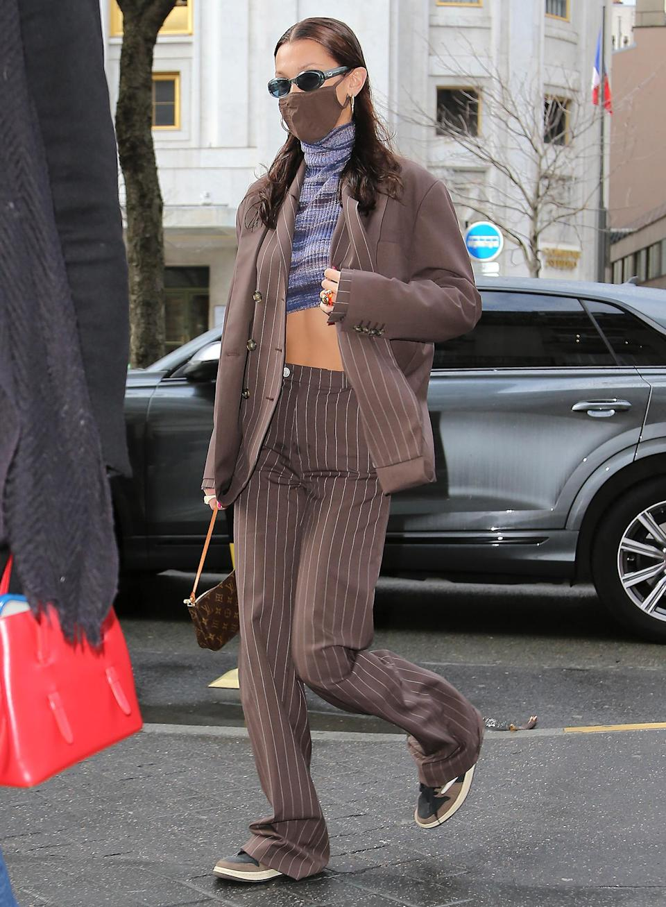<p>Bella Hadid sports a pinstripe blazer and pants set on her way to Givenchy in Paris on Thursday.</p>