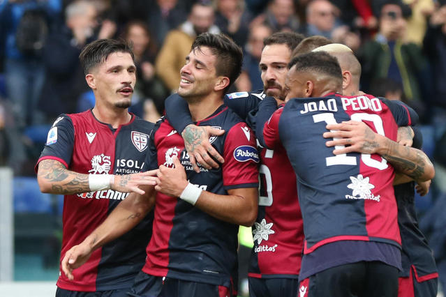 Cagliari's Giovanni Simeone, second from left, celebrates with teammates after scoring during a Serie A soccer match between Cagliari and Fiorentina at the Sardegna Arena stadium in Cagliari, Italy, Sunday, Nov. 10, 2019. (Fabio Murru/ANSA via AP)