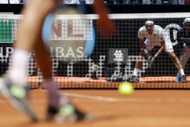 Switzerland's Roger Federer, right, waits to returns the ball during his match against Portugal's Joao Sousa at the Italian Open tennis tournament, in Rome, Thursday, May, 16, 2019. (AP Photo/Gregorio Borgia)
