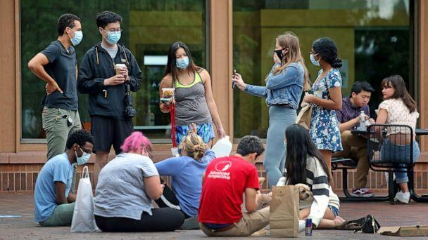 PHOTO: Students gather outdoors at the Tufts campus center in Medford, Mass., Aug. 27, 2020. (David L. Ryan/Boston Globe via Getty Images)