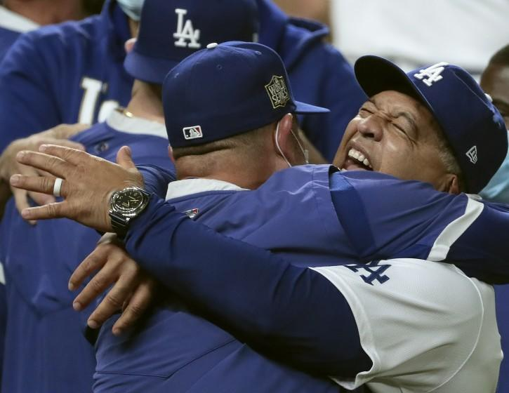 Arlington, Texas, Tuesday, October 27, 2020 Dodgers manager Dave Roberts celebrates with the team after clinching the World Series at Globe Life Field. (Robert Gauthier/ Los Angeles Times)