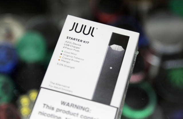 FILE - This Dec. 20, 2018, file photo shows a Juul electronic cigarette starter kit at a smoke shop in New York. Juul is the largest U.S. seller of electronic cigarettes, controlling about 70% of the market. The San Francisco-based company rose to the top through viral marketing that promoted high-nicotine pods with dessert and fruit flavors. (AP Photo/Seth Wenig)