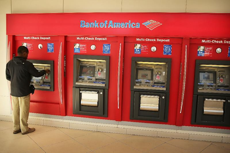 Dozens of US banks are installing new ATMs or updating existing ones to allow customers to order cash on a mobile application and then scan a code to get their money without having to insert a bank card (AFP Photo/Spencer Platt)