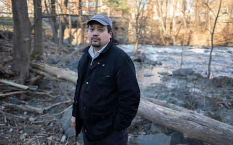 Antony Tseng, an environmental engineer with the EPA, has been forced to stay at home without pay during the government shutdown - Credit: Neville Elder