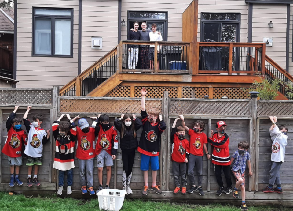 The Senators rookie had no one in the crowd to witness his first NHL hat trick, so some local kids made sure Tim Stutzle got the proper treatment.  (Photo via Twitter/@PositiveSensFan)