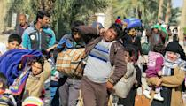 Displaced Iraqis, who fled regions controlled by the Islamic State group near Fallujah, arrive in Jwaibah, on the outskirts of Ramadi, in February 2016 (AFP Photo/Moadh Al-Dulaimi)