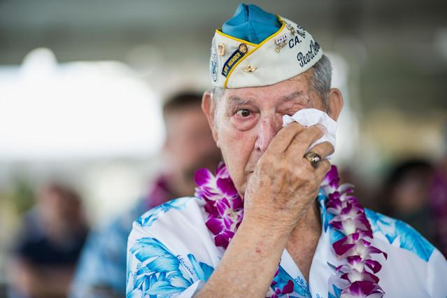 Pearl Harbor survivors Michael Ganitch of California and Robert McCoy of Hawaii talk during the 71st Annual Memorial Ceremony Pearl Harbor survivor Victor Miranda wipes his eyes during the 71st Annual Memorial Ceremony commemorating the WWII Attack On Pearl Harbor at the World War 2 Valor in the Pacific National Monument December 7, 2012 in Pearl Harbor, Hawaii. This is the 71st anniversary of the Japanese attack on pearl Harbor. (Photo by Kent Nishimura/Getty Images)
