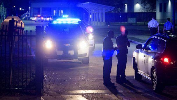 PHOTO: New Orleans police investigate after the fatal shooting of a police officer at George Washington Carver High School where a basketball game was being played, Friday, Feb. 26, 2021, in New Orleans. (Max Becherer/The Times-Picayune/The New Orleans Advocate via AP)