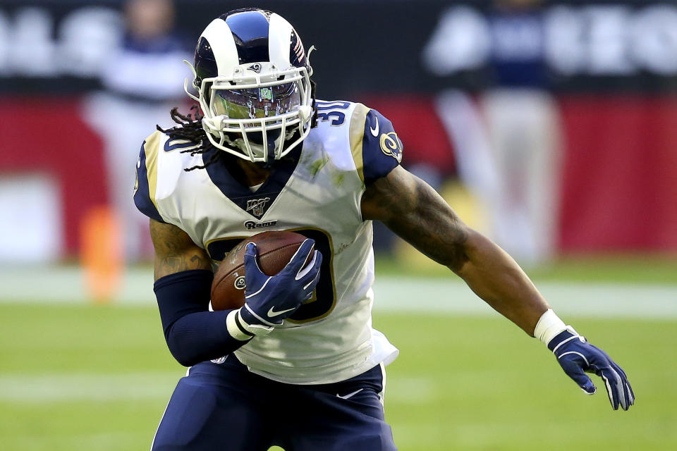Los Angeles Rams running back Todd Gurley (30) runs against the Arizona Cardinals during the first half of an NFL football game, Sunday, Dec. 1, 2019, in Glendale, Ariz. (AP Photo/Ross D. Franklin)